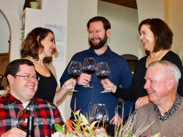 The Naumes Family toasts with glasses of red wine