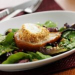 Warm Peanut-Crusted Goat Cheese with Roasted Pears & Greens